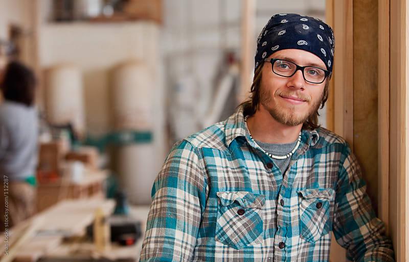 Woodworking: Man Taking Break In Workshop by Sean Locke for Stocksy United