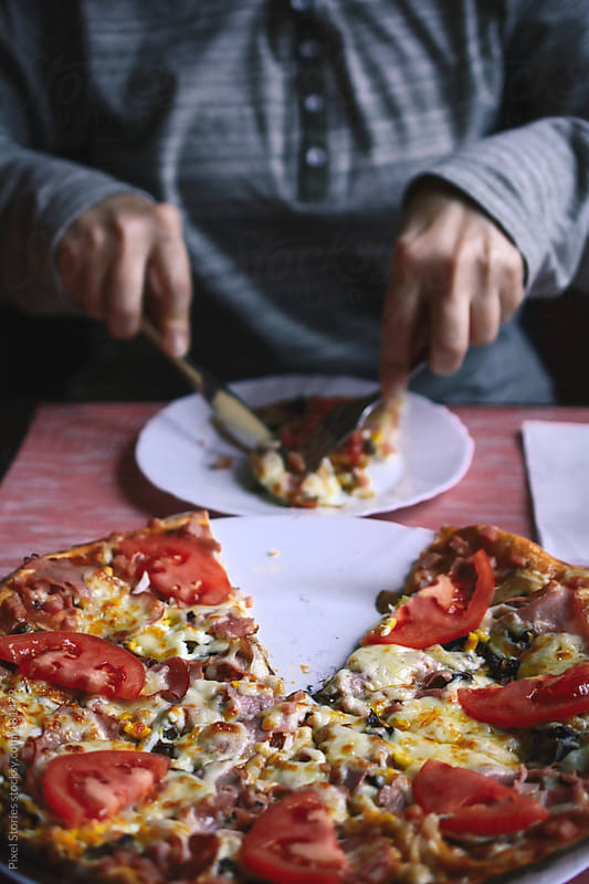 Eating pizza by Pixel Stories for Stocksy United