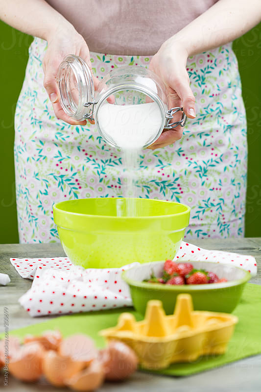 Preparing homemade strawberry ice cream by Kirsty Begg for Stocksy United