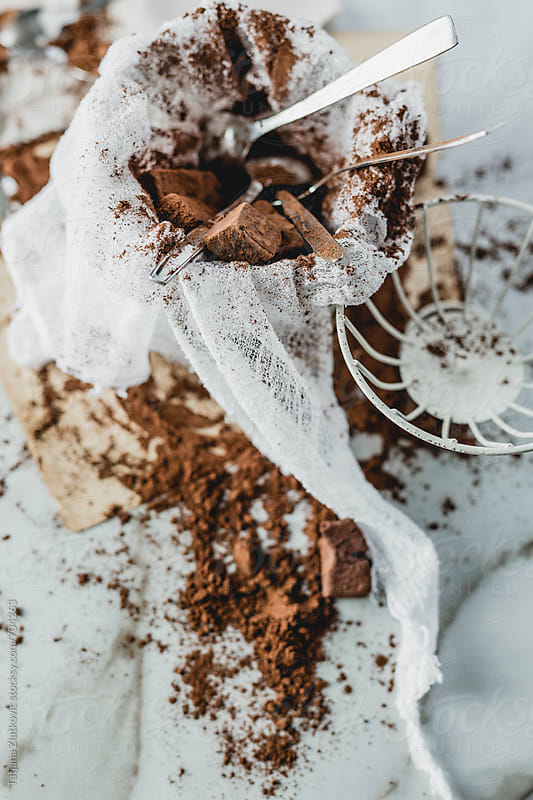 Cocoa truffles in vintage cage by Tatjana Ristanic for Stocksy United