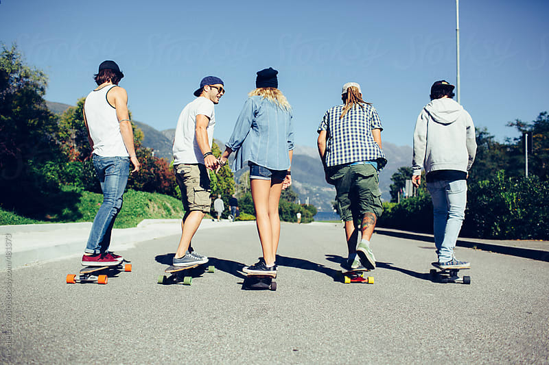 Portrait of a group of guys skateboarding by michela ravasio for Stocksy United