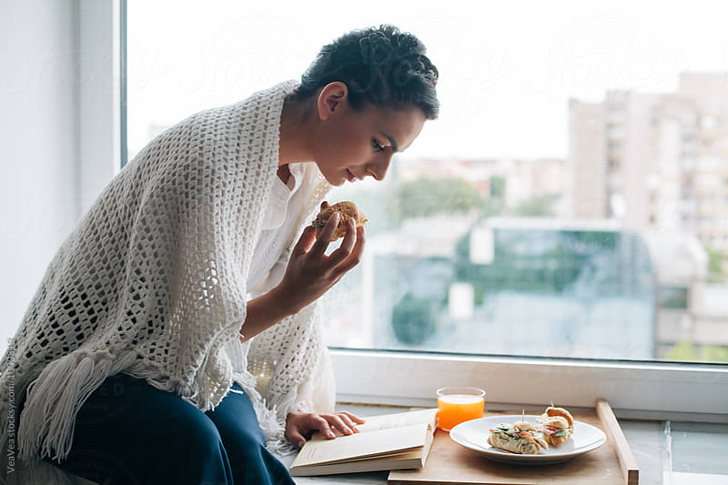 Woman having a breakfast by VeaVea for Stocksy United