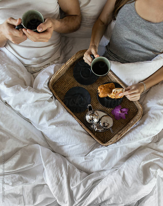 Couple Drinking Coffee in Bed by VISUALSPECTRUM for Stocksy United