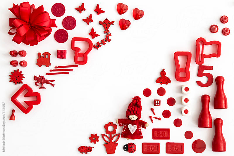 Collection of red toys on white background by Melanie Kintz for Stocksy United
