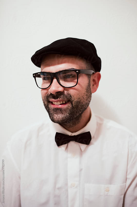 Portrait of a handsome man with glasses smiling by Jovana Rikalo for Stocksy United