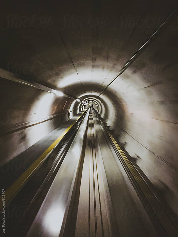 Metro tunnel with motion blur by Juri Pozzi for Stocksy United
