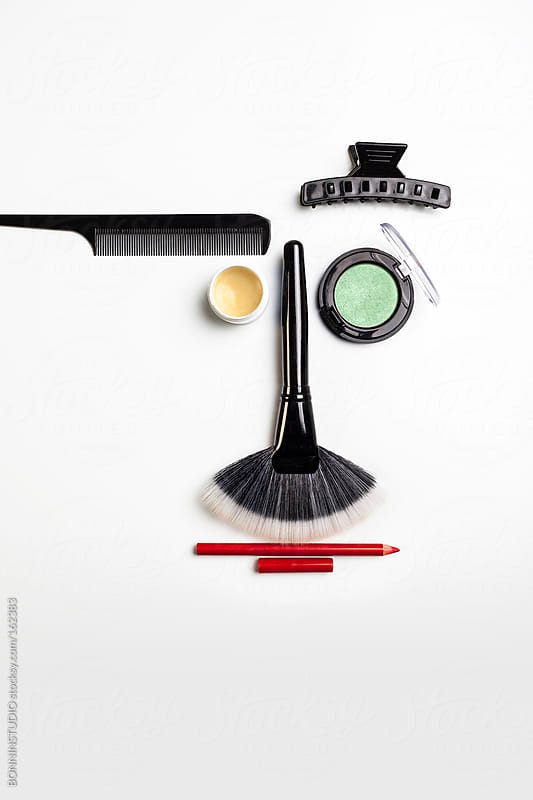 Makeup face. A face shape with different makeup tools. by BONNINSTUDIO for Stocksy United