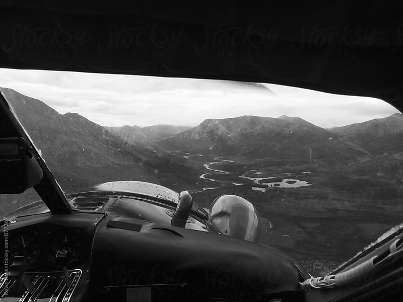 View of Mountains from Small Plane Cockpit by Kevin Russ for Stocksy United