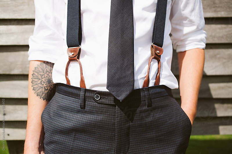 Waist of well dressed man with tie and suspenders by Denni Van Huis for Stocksy United