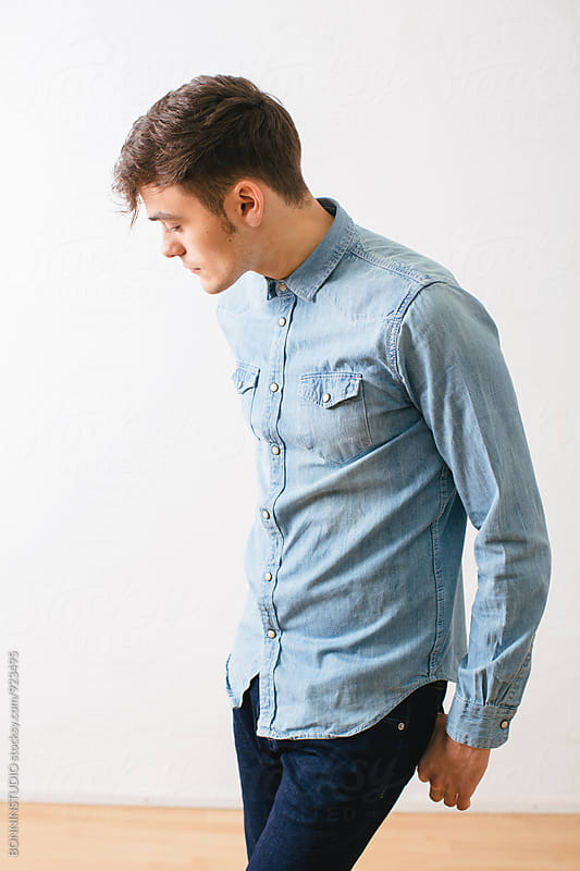 Young man wearing denim clothes. by BONNINSTUDIO for Stocksy United