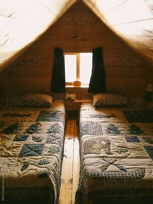 Beds in a Log Cabin Loft by Willie Dalton for Stocksy United