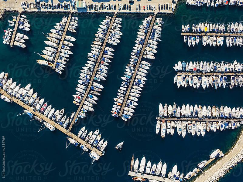 Boats Docked in a Marina by Lumina for Stocksy United