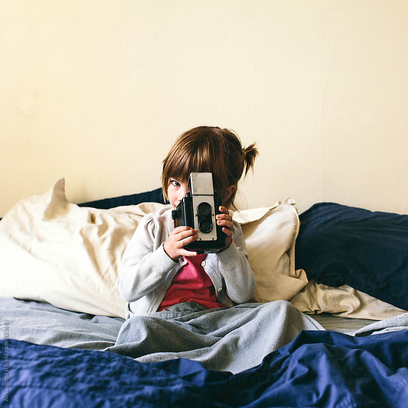 Child making a photograph by Ali Lanenga for Stocksy United