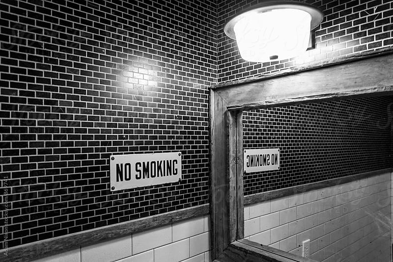 No Smoking sign in a bathroom by Adam Nixon for Stocksy United