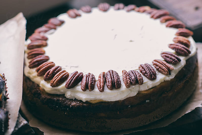 Cheesecake with chocolate and pecan nuts by Adrian Cotiga for Stocksy United