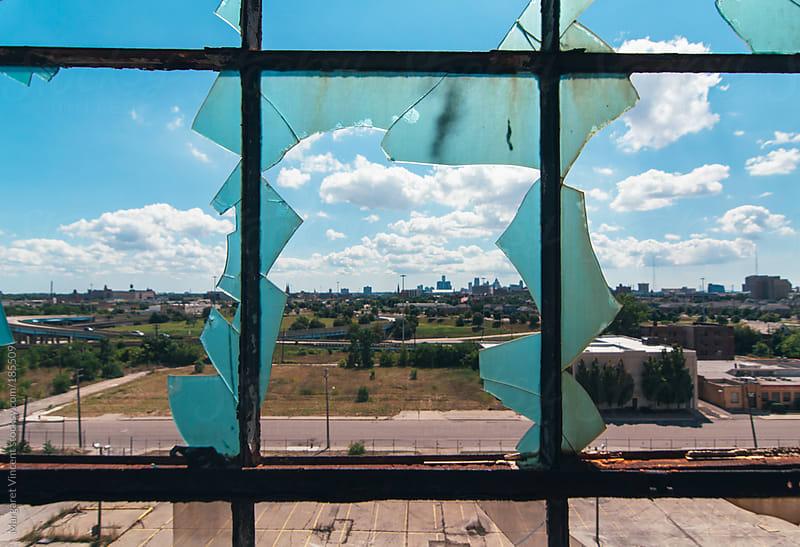 broken glass windows by Margaret Vincent for Stocksy United