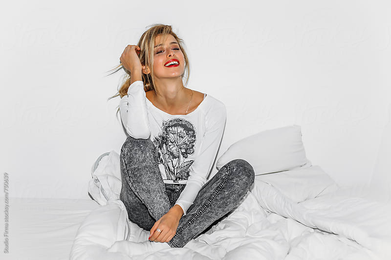 Blond Girl Laughing in the Bed by Studio Firma for Stocksy United
