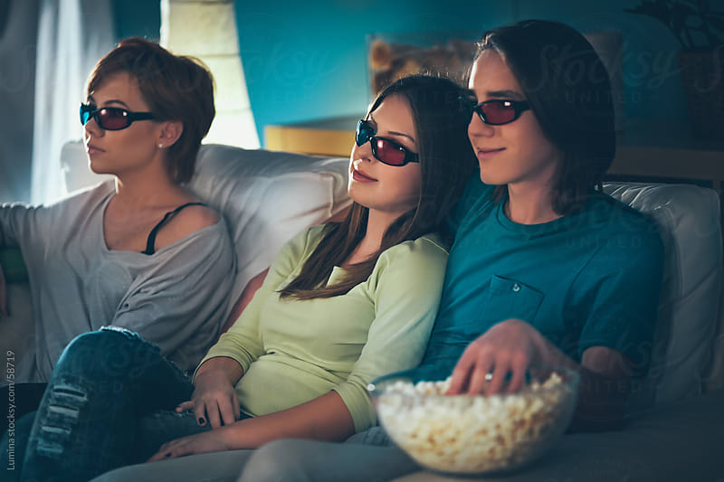 Teenagers Watching a 3D Movie by Lumina for Stocksy United
