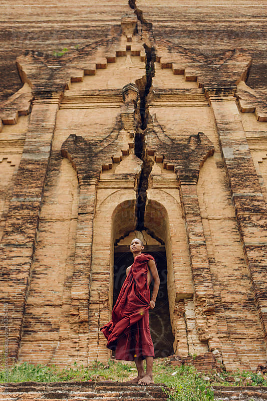 a novice Buddhist monk in a old temple