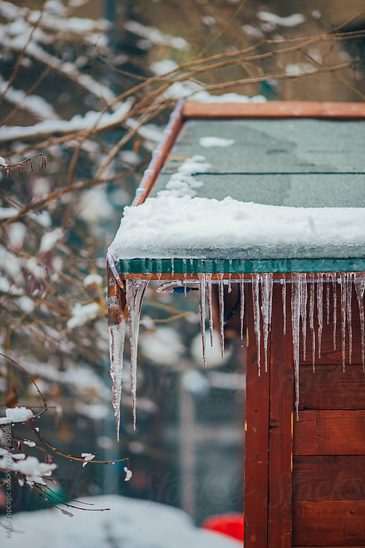 Little wooden house with icicles by Maja Topcagic for Stocksy United