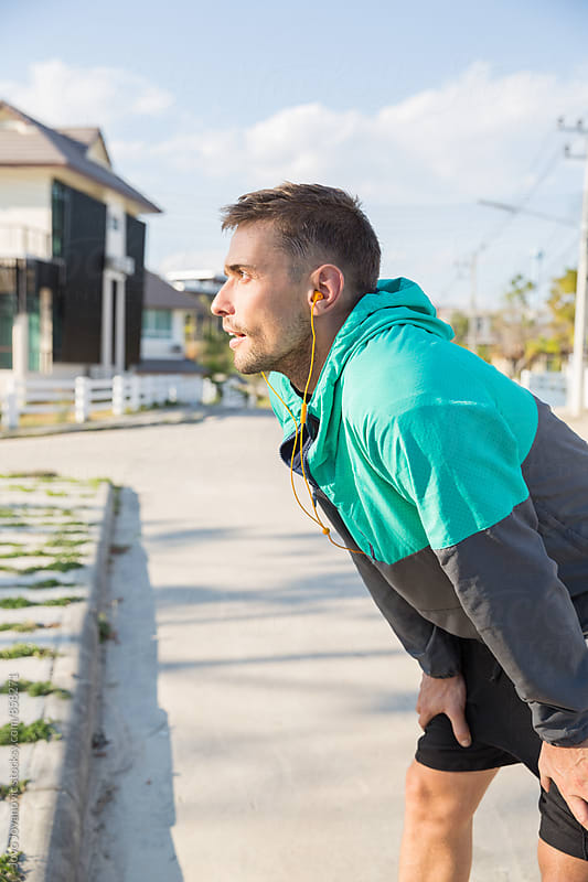 Handsome and healthy young man working out in the street  by Jovo Jovanovic for Stocksy United