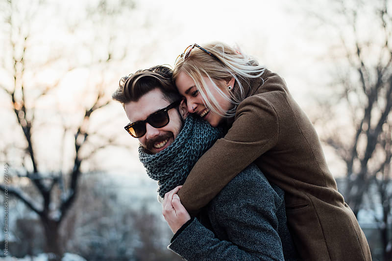 Happy Blond Woman Hugging Her Boyfriend by Nemanja Glumac for Stocksy United