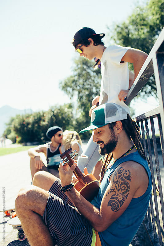 Group of guys having fun outdoors by michela ravasio for Stocksy United