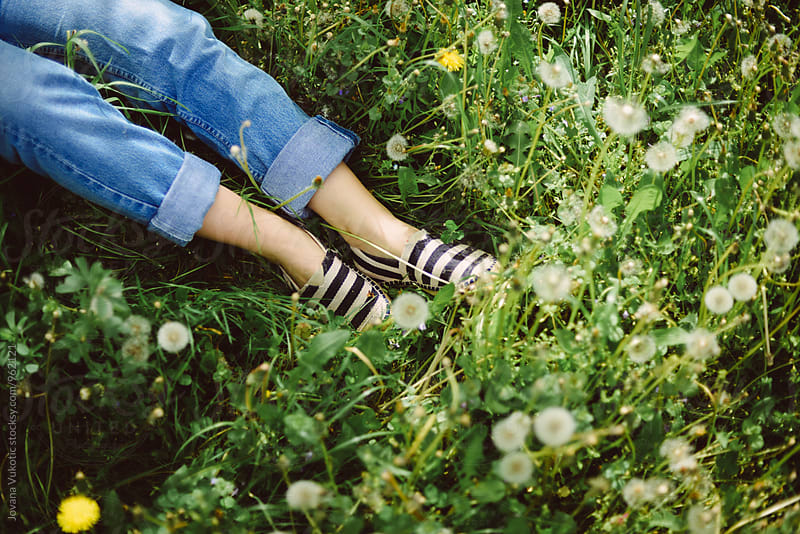 resting in the grass by Jovana Vukotic for Stocksy United