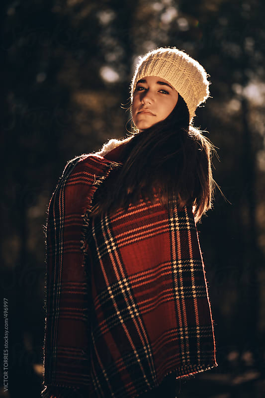 Young Woman Covering Her Body with a Red Blanket by VICTOR TORRES for Stocksy United