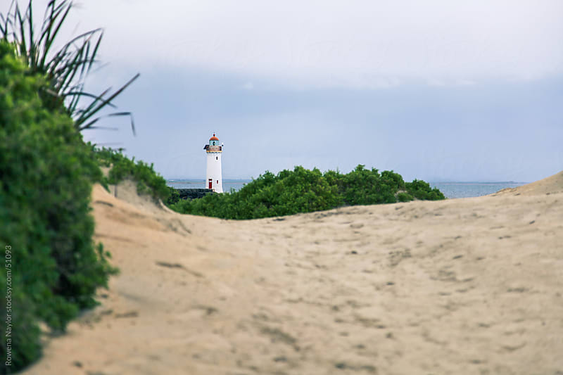 LIghthouse shot from the ground by Rowena Naylor for Stocksy United