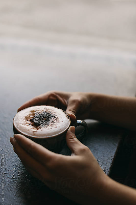 Woman Hands Holding Hot Cappuccino in a Coffee Shop by Victor Torres for Stocksy United