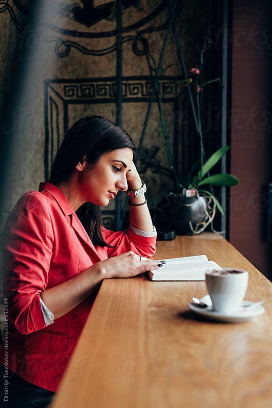 Woman in cafe by Dimitrije Tanaskovic for Stocksy United