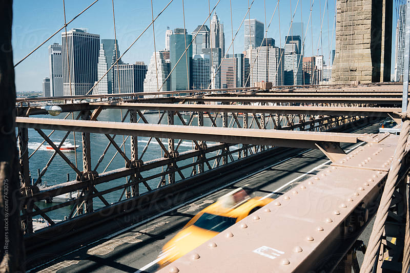 Taxi Driving Through Brooklyn Bridge by Austin Rogers for Stocksy United