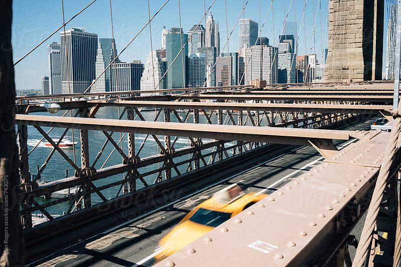 Taxi Driving Through Brooklyn Bridge by Austin Rogers for Stocksy United