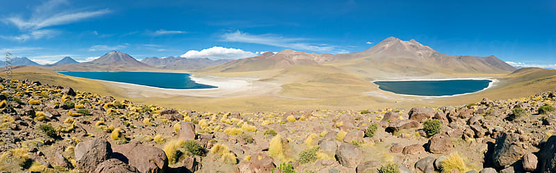 South America, Chile, Norte Grande, Antofagasta Region, Atacama desert, Los Flamencos National Reserve, Panoramic view of Laguna Miscanti and Laguna Miniques at an altitude of 4300m and the peaks of Cerro Miscanti and Cerro Miniques reaching altitudes of  by Gavin Hellier for Stocksy United