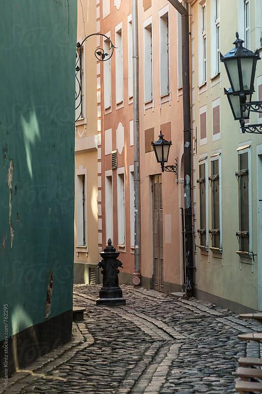 Narrow street in the old town of Riga, Latvia by Melanie Kintz for Stocksy United