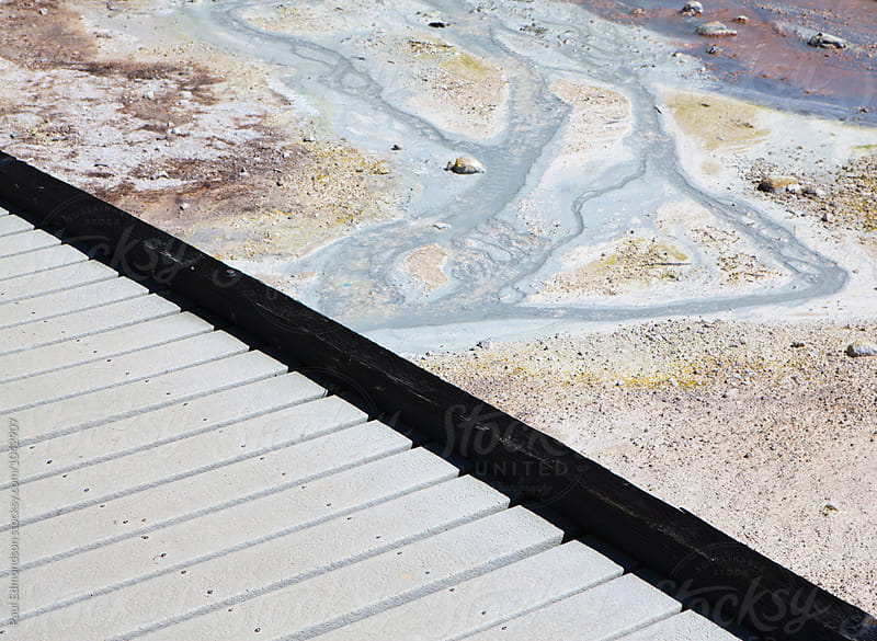 Detail of boardwalk over geyser hot springs and mineral deposits by Paul Edmondson for Stocksy United