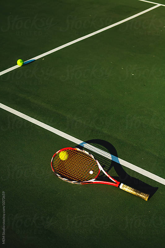 Tennis racket on a court by MEM Studio for Stocksy United