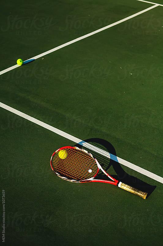 Tennis racket on a court by MEM Studio for Stocksy United