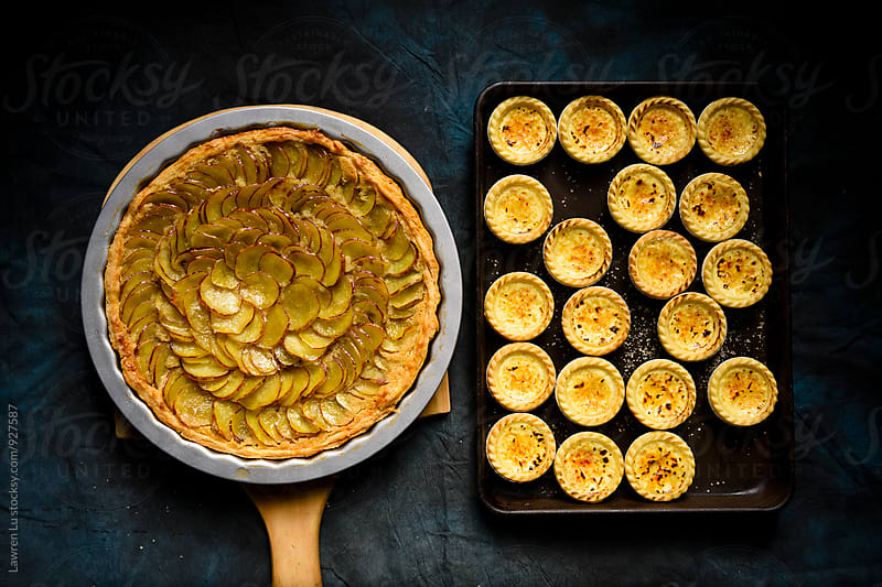 Delicious sweet potatoes pie and caramel custard on baking pans by Lawren Lu for Stocksy United