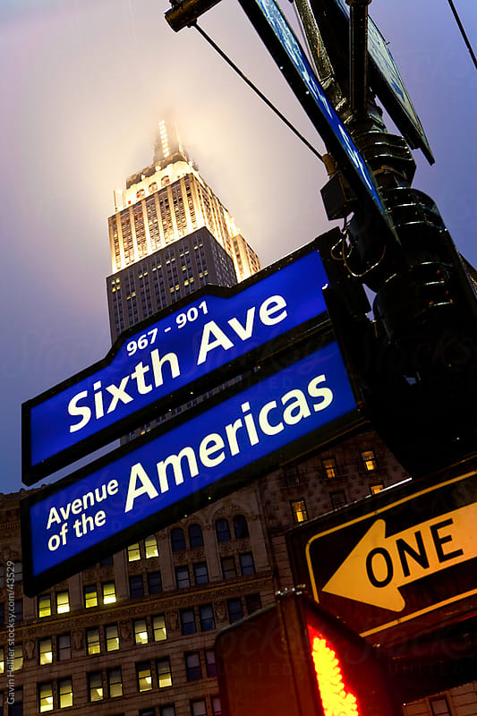USA, New York City, Manhattan, Sixth Avenue on a rainy evening- low angle view by Gavin Hellier for Stocksy United