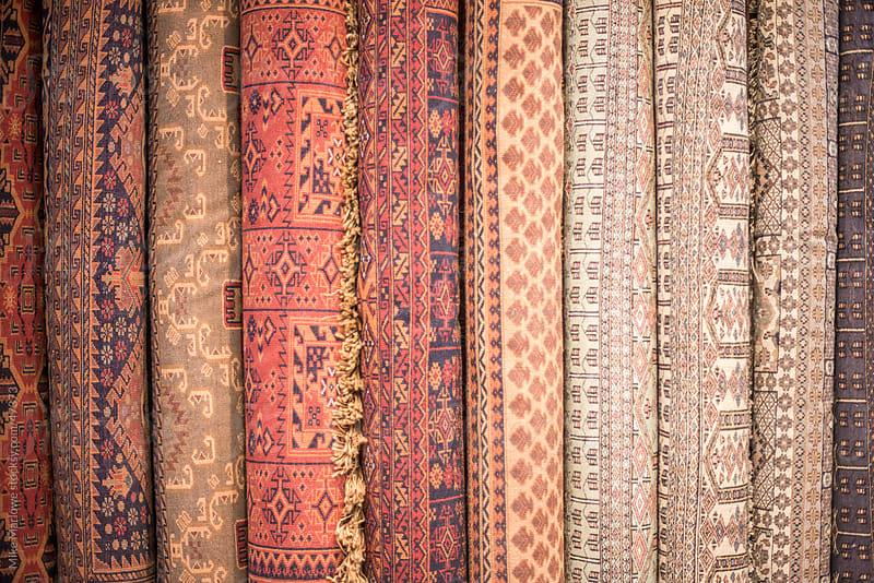 Rolls of carpets stacked against a wall. by Mike Marlowe for Stocksy United
