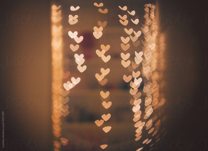 Defocused Heart-Shaped Christmas Lights by Lumina for Stocksy United