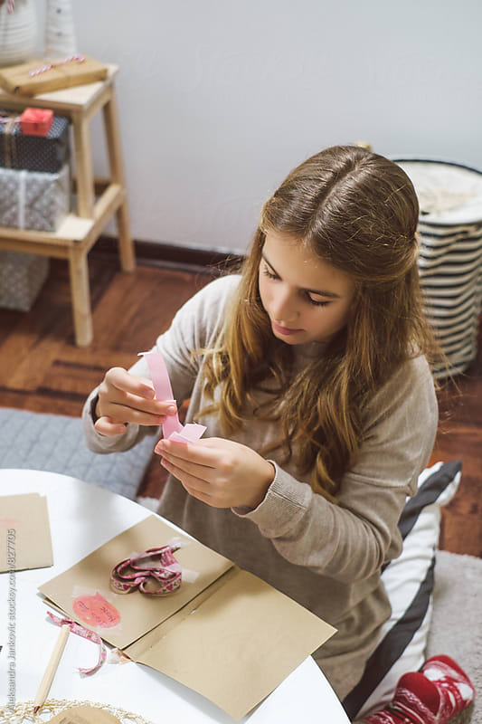 Teenage Girl Making Cards for Christmas by Aleksandra Jankovic for Stocksy United
