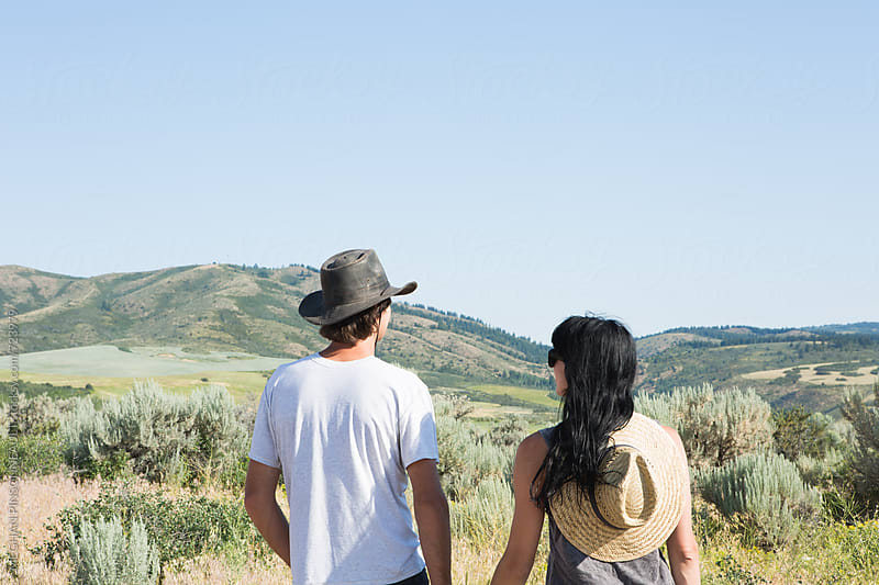 Close up of Couple Enjoying the Landscape Together by MEGHAN PINSONNEAULT for Stocksy United