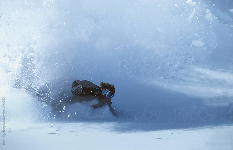 Man snowboarding deep powder snow on the mountain by Soren Egeberg for Stocksy United