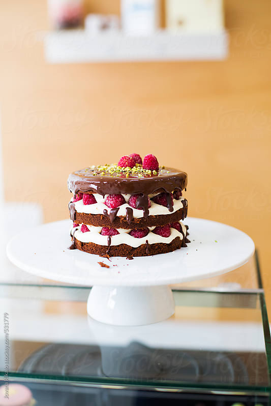 Chocolate cake with raspberries by Jovana Rikalo for Stocksy United