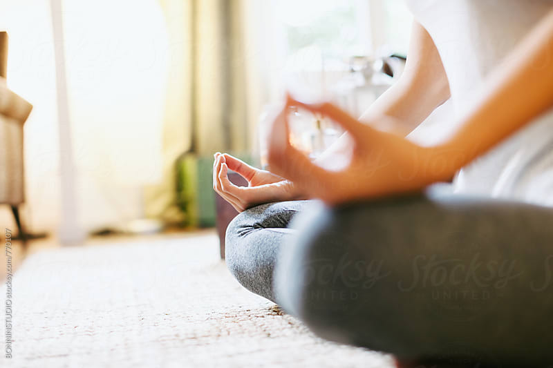 Closeup of a woman meditating in the lotus pose. by BONNINSTUDIO for Stocksy United