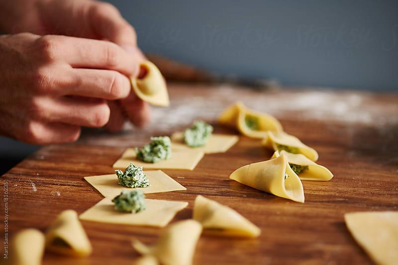 Preparing homemade fresh pasta by Martí Sans for Stocksy United