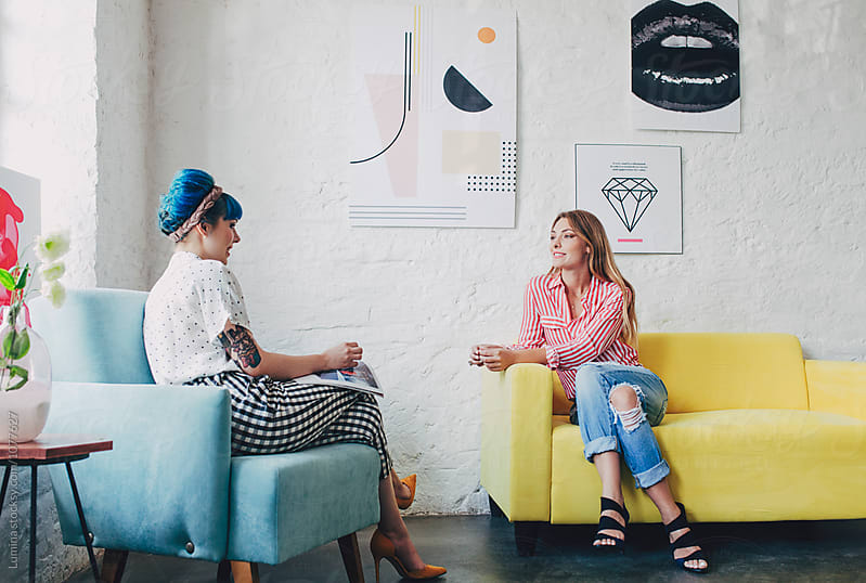 Two Stylish Women Chatting by Lumina for Stocksy United